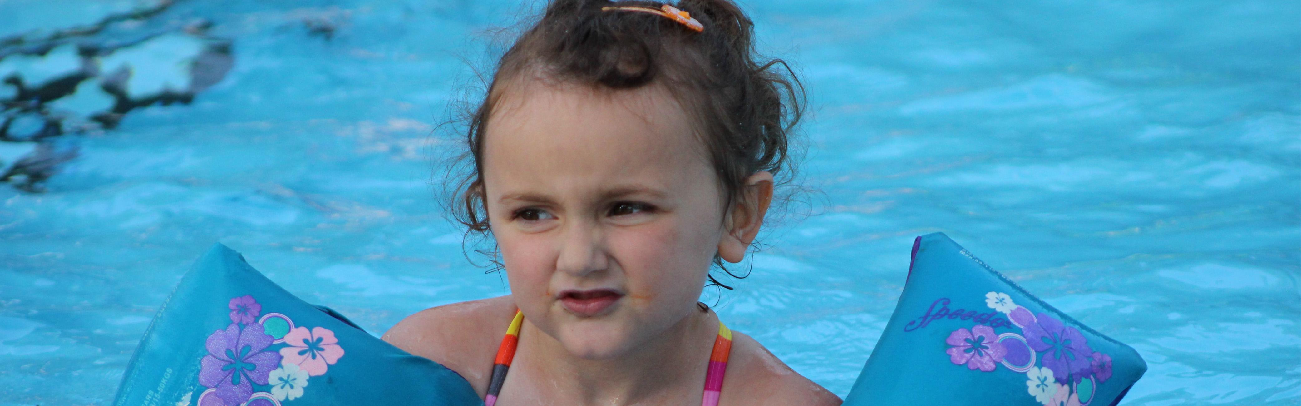 girl in floaties